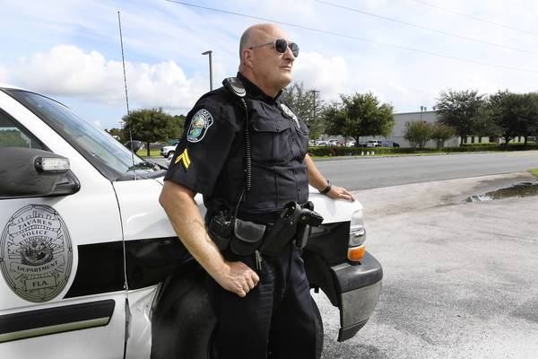 Tavares police Cpl. Michael Woods, shown near the Blue Rhino propane depot in Tavares on Wednesday, will receive a medal of valor for his rescue of a Blue Rhino propane depot employee who got hit by a car in the aftermath of an explosion July 29.