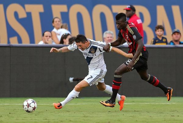 Galaxy captain Robbie Keane, left, operates against AC Milan's Mbaye Niang in the third-place match of the Guinness International Champions Cup tournament at Miami Gardens, Fla., on Aug. 7.