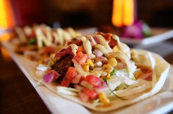 Fish tacos topped with avocado ranch, pico de gallo and creamy corn salsa at The Hangar in College Park.