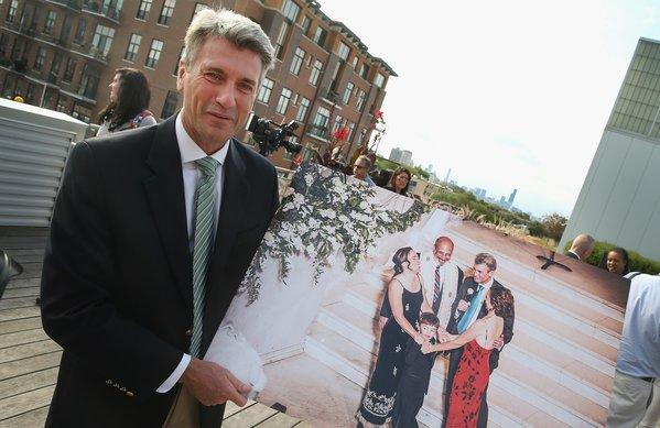 "Minneapolis Mayor R.T. Rybak shows a picture taken while he officiated at the marriage of Margaret Miles and Cathy ten Broeke. Rybak was in Chicago to unveil an advertising campaign called ""I Want to Marry You in Minneapolis"" which invites same-sex couples from Chicago to travel to Minneapolis to get married."
