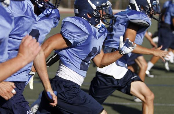 Crescenta Valley High football players run drills on campus during the summer. The Falcons open their season this Friday. (Raul Roa/Staff Photographer)