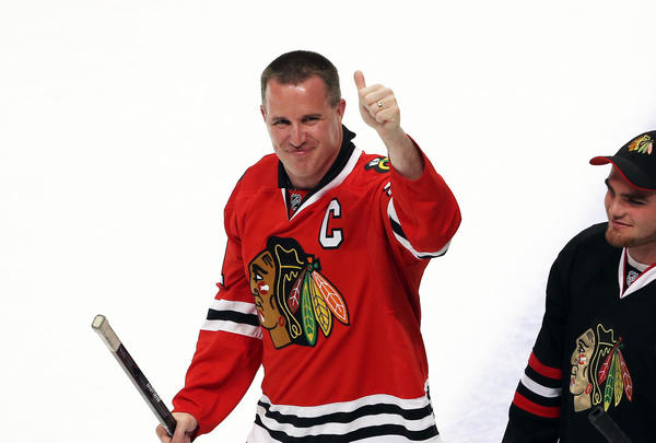 Northwestern football coach Pat Fitzgerald gives a thumbs up after participating in the Shoot the Puck promotion after the second period of the game between the Chicago Blackhawks and the Nashville Predators last April.