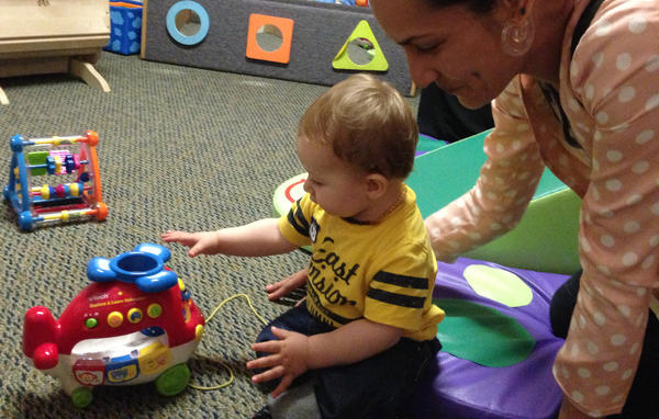 Single mother Beth Capper plays with her son Ezekiel Goss at the Children's Institute Inc.'s Mid-Wilshire campus in July.