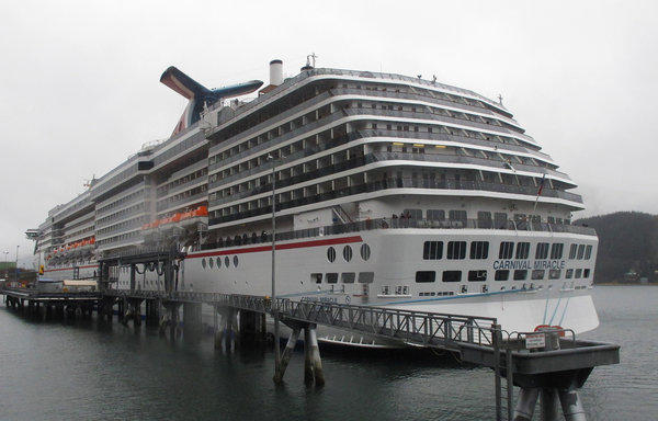 The Carnival Miracle docked in Juneau. Carnival Corp. will install scrubbers to cut sulfur oxide emissions and filters to capture soot from 32 cruise ships over the next three years.