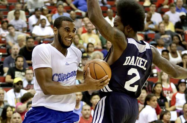 Clippers forward Brandon Davies drives to the basket against Hawks forward Ed Daniel in the fourth quarter of an summer league game.