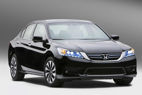 The 2014 Honda Accord Hybrid EPA figures put it at the top of its class for city fuel economy, with a 50 mpg rating. Highway economy is 45 mpg, while the car gets a combined 47 mpg.