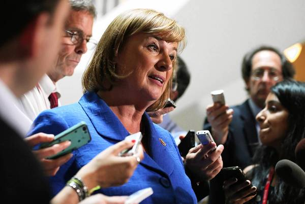 Rep. Carol Shea-Porter (D-N.H.) speaks to reporters after a closed-door briefing on Syria. She was among the lawmakers who were inclined to vote against authorizing force to punish Syria.
