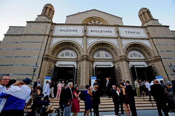 Congregants talk after Rosh Hashana services at the newly restored Wilshire Boulevard Temple.