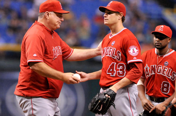 "Manager Mike Scioscia says Garrett Richards (43) and other Angels starters won't be given a reduced workload the rest of the season. ""We have to continue to play strong, play hard and play well,"" Scioscia says."