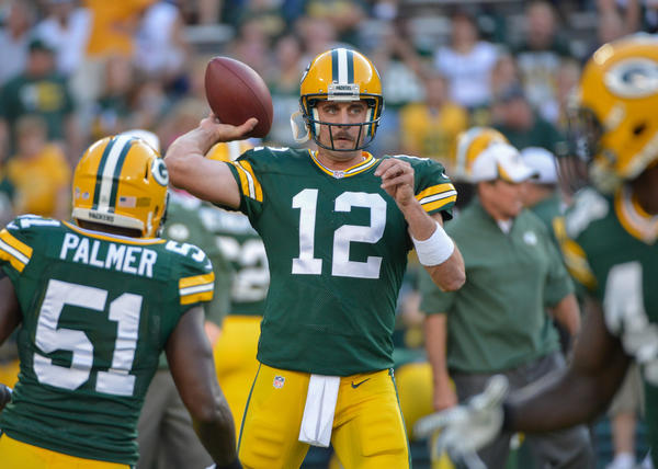 Packers quarterback Aaron Rodgers warms up before game against the Seahawks.
