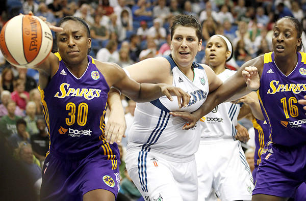 Sparks forward Nneka Ogwumike (30) tries to grab a loose ball in front of Lynx forward Janel McCarville during the second half of their game Wednesday night in Minneapolis.