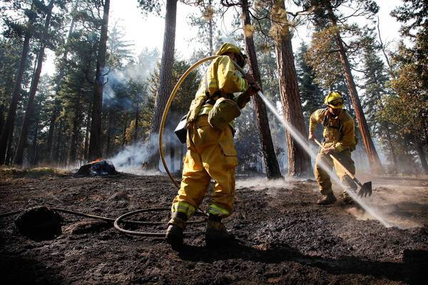 Firefighters create a fire break at the edge of Yosemite on Aug. 27. About a quarter of the Rim fire is now burning in the national park.