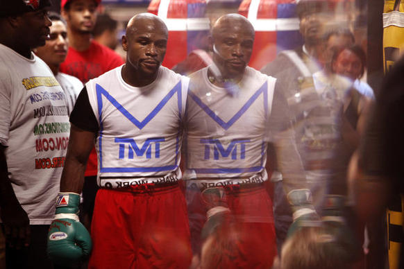 Boxing champion Floyd Mayweather Jr. is reflected in a mirror during a training session at his gym in Las Vegas.