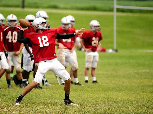 Parkland's Nick Zambelli #12 throws deep downfield during practice on Monday.
