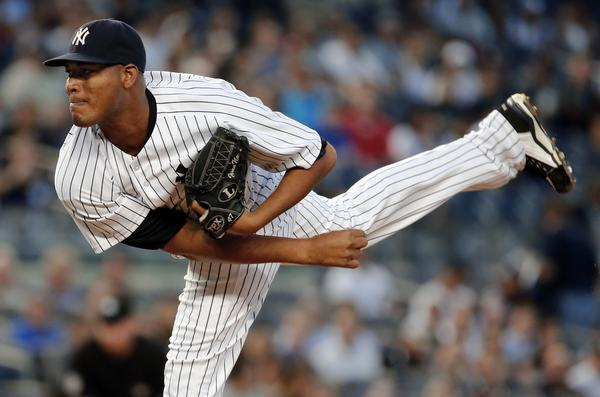The Yankees' Ivan Nova follows through on a pitch to the Red Sox in the first inning Thursday at Yankee Stadium. Nova gave up five hits, three runs and walked two in four innings.