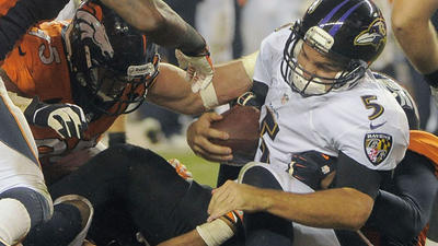 Ravens blown out by Broncos on record-setting night for Peyton …