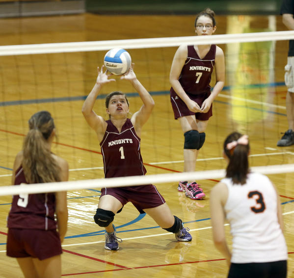Aberdeen Christian's Amanda Williams, center, tries to set the ball as teammates Hannah Lopes, left, and Aimee Vilhauer (7) look on along with Ipswich's Ansley Sargent (3) during Thursday night's match at the Aberdeen Civic Arena.
