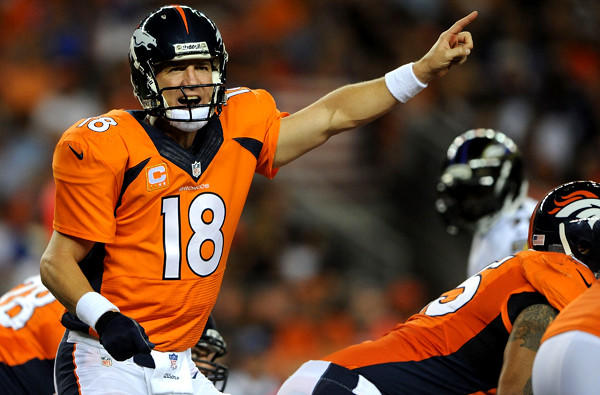 Broncos quarterback Peyton Manning communicates with his teammates as they prepare to run a play against the Baltimore Ravens in their season-opening game in Denver.