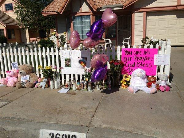 A makeshift memorial went up in front of the home of a 7-year-old Palmdale girl who was shot Wednesday morning and remains on life support.