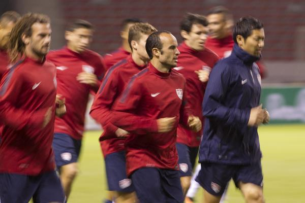 Landon Donovan and his U.S. soccer teammates run during a training session Thursday ahead of their 2014 World Cup qualifying soccer match with Costa Rica on Friday night in San Jose, Costa Rica.