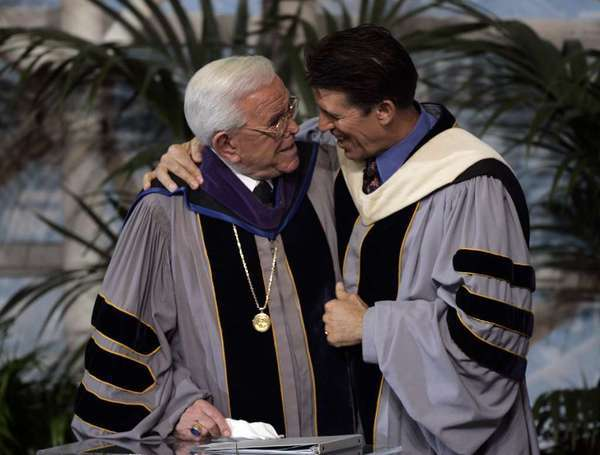 Robert A. Schuller, right, with his dad, Robert H. Schuller, at a Chrystal Cathedral service Jan. 1, 2006, in Garden Grove.