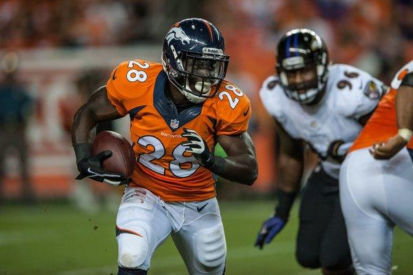 Running back Montee Ball, No. 28 of the Denver Broncos, rushes against the Baltimore Ravens.