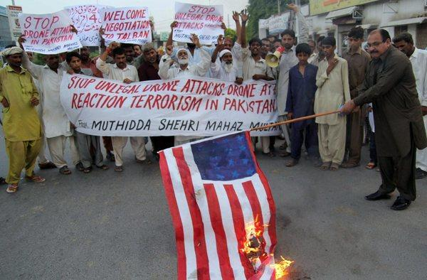 Protesters set an American flag on fire and shout slogans during a protest last week against a suspected U.S drone attack in the North Waziristran tribal area of Pakistan.
