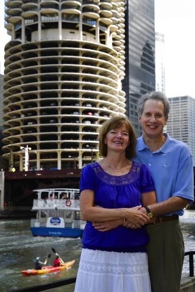 Julie and Kevin McLaughlin stand together near the Marina City Towers, Monday, Sep. 2, 2013. Despite having grown up near each other and having gone to the same school, they didn't meet until they became co-workers at the former Marina City Bank.