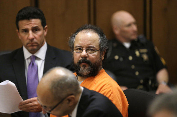 Ariel Castro sits in a Cleveland courtroom after pleading guilty to 937 counts of rape and kidnapping for holding three women captive in his home for a decade.