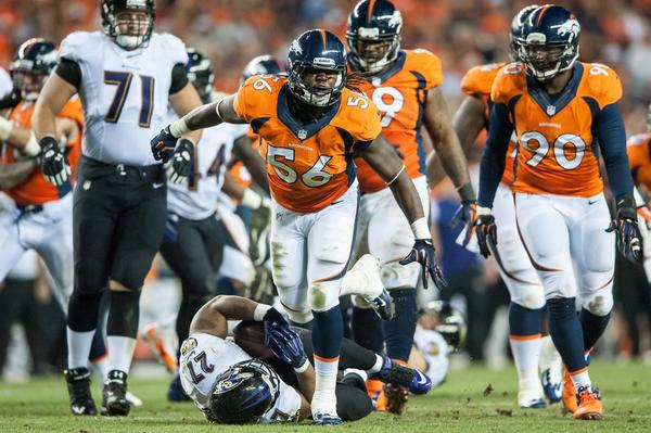 Linebacker Nate Irving #56 of Denver Broncos celebrates a tackle of Baltimore Ravens running back Ray Rice #27 during the game in Denver, Colorado.