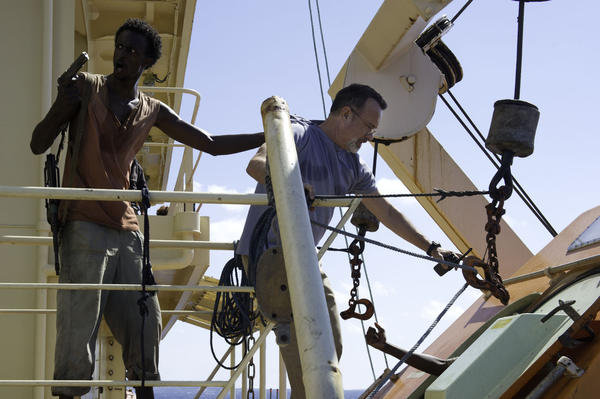 "Faysal Ahmed, left, and Tom Hanks star in director Paul Greengrass' hijacking action-drama ""Captain Phillips."""