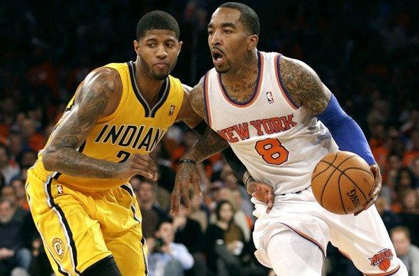 Knicks guard J.R. Smith drives past Pacers forward Paul George during a playoff game last season.