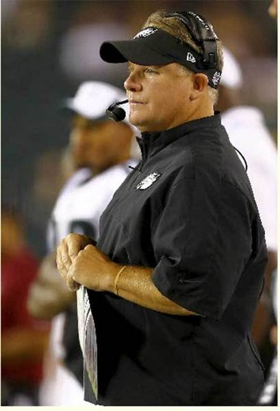 PHILADELPHIA, PA - AUGUST 15: Head coach Chip Kelly of the Philadelphia Eagles looks on from the sideline in the second half against the Carolina Panthers on August 15, 2013 at Lincoln Financial Field in Philadelphia, Pennslyvania.
