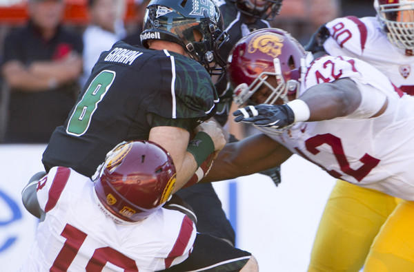 USC linebackers Dion Bailey (18) and Devon Kennard (42) sack Hawaii quarterback Taylor Graham during the Trojans' 30-13 rout of the Rainbow Warriors.