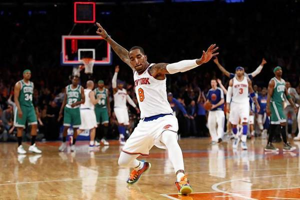 New York Knicks' J.R. Smith celebrates after sinking a three point basket at the buzzer at the end of the first quarter against the Boston Celtics in Game 2 of their NBA Eastern Conference basketball playoff series in New York.