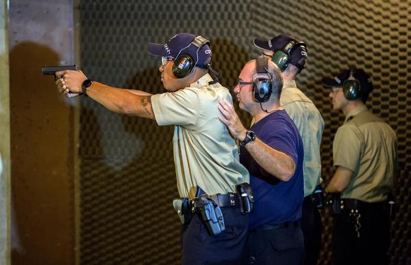 Police recruits practice at the shooting range before the arrival of Chicago Police Supt. Garry McCarthy at the CPD Police Academy.
