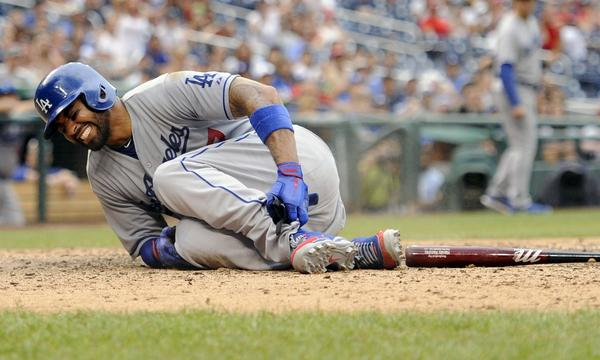 Dodgers outfielder Matt Kemp reacts after spraining his ankle against the Washington Nationals in July. Kemp experienced tightness in his right hamstring Friday while running bases at the team's minor league facility.