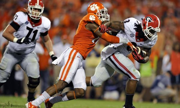 Georgia running back Todd Gurley, right, breaks a tackle by Clemson's Bashuad Breeland during the Bulldogs' loss Saturday. Georgia could find some redemption in the rankings with a win over South Carolina this week.