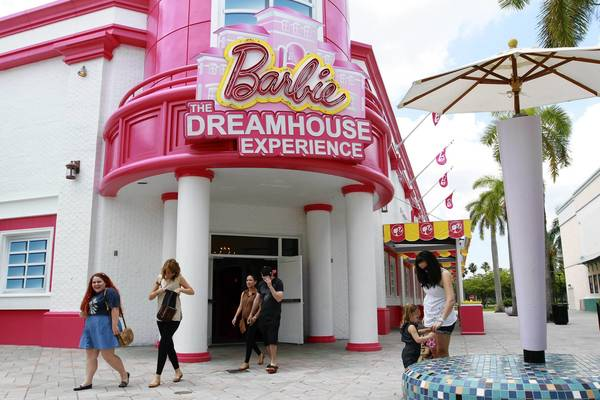 "Patrons leave a life-size house: ""Barbie The Dreamhouse Experience"" at Sawgrass Mills Mall in Sunrise on Thursday, May 9,"