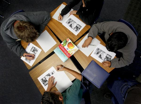 California must overhaul its testing system as part of schools' adoption of the Common Core curriculum. Above, students work in groups at an elementary school in Santa Ana, where there is an effort to emphasize critical thinking and prepare students for more complex tests that do not involve multiple-choice answers.