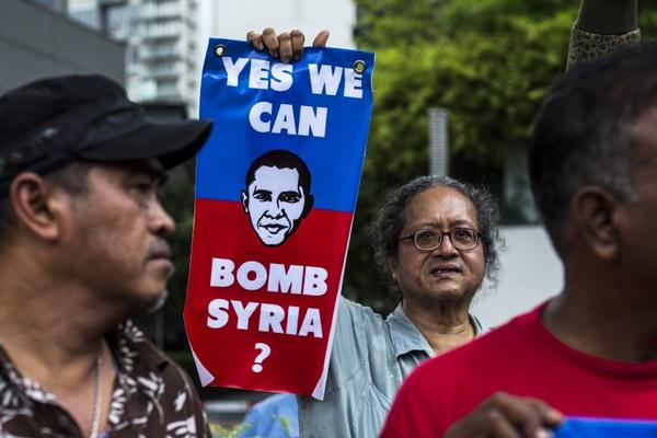 Malaysian activists protest against a possible military strike on Syria outside the U.S. embassy in Kuala Lumpur on Friday.