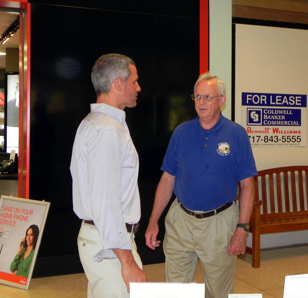 State Rep. Rob Kauffman, R-Franklin/Cumberland chats with 73-year-old Louis Willett, Chambersburg, Pa., at Friday's annual Senior Fair held at the Chambersburg Mall.