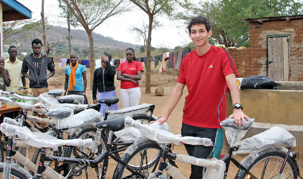St. Francis High senior Sebouh Bazikian with the bikes he fundraised for and presented to 43 orphans at the Machao Orphanage in Makueni, Kenya, in August.