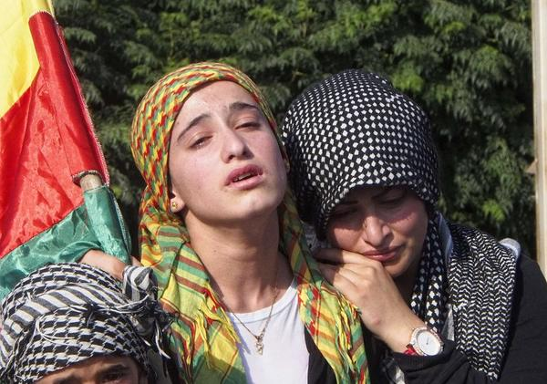 Mourners attend a Kurdish funeral in northern Syria, where the Kurds declared their own autonomous region in July.