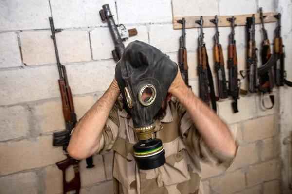 A Syrian rebel tries on a gas mask seized from an army factory in the northwestern province of Idlib. The United States is weighing a military strike against Bashar Assad's regime for an alleged chemical weapons attack on civilians.