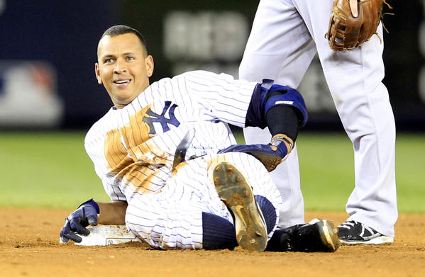 Alex Rodriguez smiles after he slid awkwardly into second base following his double in the bottom of the 4th inning against the Red Sox.