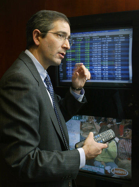 Comcast Corp. Chairman and Chief Executive Brian Roberts demonstrates an early version of videoondemand services in 2002. VOD has finally reached 60% of TV homes in the U.S., according to a new Nielsen study.