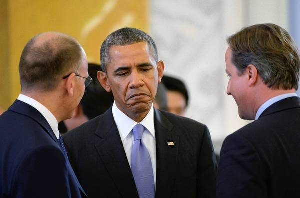 President Obama talks with British Prime Minister David Cameron, right, and Italian Prime Minister Enrico Letta at the G-20 summit in St. Petersburg, Russia.
