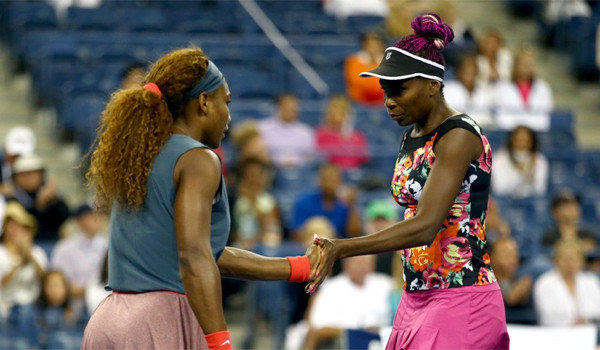 Serena Williams and Venus Williams were eliminated in doubles play at the U.S. Open.