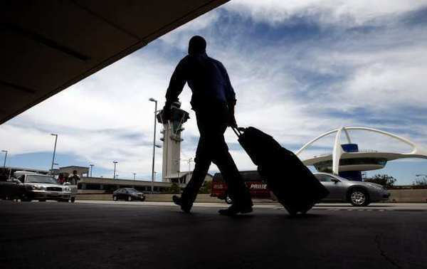 Los Angeles ranks 17th in the nation in popularity among business travelers, according to a study. Above, a traveler at Los Angeles International Airport.